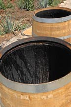 A French white oak barrel, is charred at Tres Mujeres Tequila